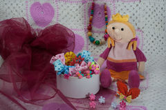 Different colored gums, pins, beads, bows for girls. Beauty salon for a little princess. Stock Photos