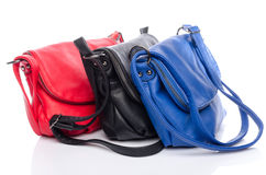 Different colored handbags Royalty Free Stock Photos