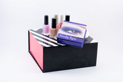 Different colored nail polish and smoky eyes ocean blue make up box Royalty Free Stock Photos