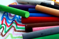 Different Colored Pastels or coloring materials Stock Images