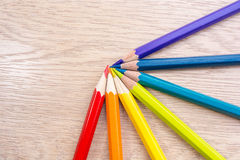 Different colored pencils photo with space for text. Seven pencils of rainbow colors lie on the table. Copyspace. Back to school. Stock Photos