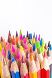 Different colored pencils photo with space for text. Seven pencils of rainbow colors lie on the table. Copyspace. Back to school. White background Stock Images