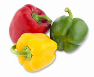 Different colored peppers. Isolated Stock Images