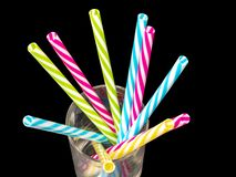 0614 Different colored plastic drinking straws placed in a glass black background. Different colored plastic drinking straws placed in a glass black background stock photos