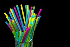 0613 Different colored plastic drinking straws placed in a glass black background. Different colored plastic drinking straws placed in a glass black background royalty free stock image