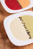 Different colored puree soups. (cauliflower, pea, carrot and beet Stock Images