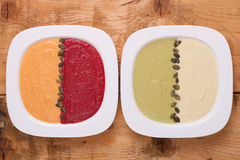 Different colored puree soups Stock Photos