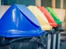Different colored recycle garbage trash Bins in the park. Royalty Free Stock Photos