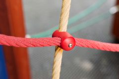 Different colored ropes with plastic fastenings on the playground. Different colored ropes with plastic fastenings on the children playground royalty free stock images