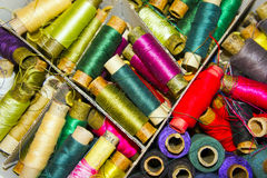 The different colored spools of thread. Closeup royalty free stock photos