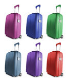 Different colored suitcases Stock Photos