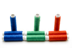 Different colored thread rolls Stock Photo