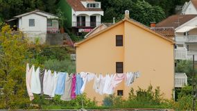 Different colored underwear drying outside on the roof stock footage