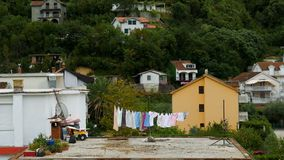 Different colored underwear drying outside on the roof in Montenegro stock video footage
