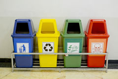 Different Colored wheelie bins set with waste icon. Closeup Different Colored wheelie bins set with waste icon Stock Images