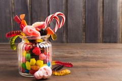 Different colorful candies on glass jar woth sweet skulls, reat Royalty Free Stock Images