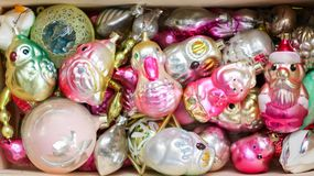 Different colorful Christmas toys on a box. Birds, man, animals, balls royalty free stock image