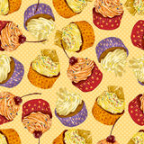 Different colorful delicious cupcakes. Seamless pattern Royalty Free Stock Images