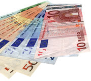 Different colorful euro isolated, savings wealth. Pile of different grunge (grungy) colourful money (savings in 10, 20, 50, 100 euro banknotes) isolated on white Royalty Free Stock Photos