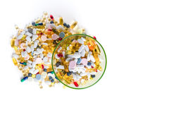 Different colorful medication and pills from above on white background. Many different colorful medication and pills from above on white background with copy Royalty Free Stock Image