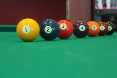 Different colorful numbered snooker balls placed in a line Royalty Free Stock Images