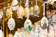 Different colorful painted Easter eggs on the tree at traditional European market Stock Images
