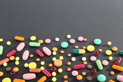 Colorful pills. Different colorful pills on black background Royalty Free Stock Photos