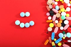 Colorful pills. Different colorful pills on red background Royalty Free Stock Photos