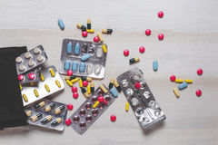 Different Colorful Pills, Tablets And Capsules On White Wooden Table, Top View Royalty Free Stock Images