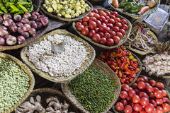 Different colorful raw grain and vegetables on shelfs on a market Stock Images