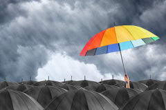 Different colorful umbrella holding Stock Photo