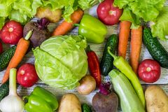 Different colorful vegetables all over the table in full frame. Healthy eating.  stock photos
