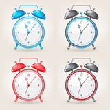 Different colors alarm clock Royalty Free Stock Photography