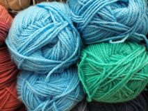 Different colors yarn, multicolored threads. Different colors blue and green yarn, multicolored stock photo