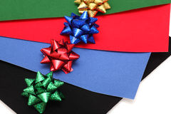 Different colors bows on different colors velvet paper Stock Image