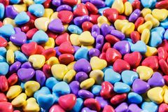 Different colors of chewing gum and candy. In the shape of a heart. background of sweets royalty free stock images