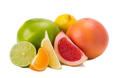 Different colors of citrus fruits, with vitamin C on white background royalty free stock image