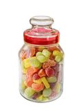 Different colors of confectionary in the glass jar Royalty Free Stock Photo