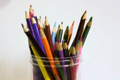 Numerous coloring pencils arranged in a container. Different colors in a container, ready to use. Numerous of different color pencils in a container Stock Photos