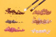 Different colors of crumbled compact eyeshadow Stock Image
