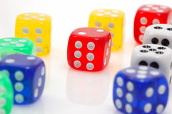 Different colors of dices. Focus in red dice.. casino concept Stock Photos