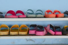 Different colors pair of sandals royalty free stock photo
