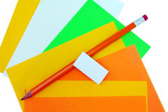 Different colors of papers and pencil with eraser Royalty Free Stock Photo