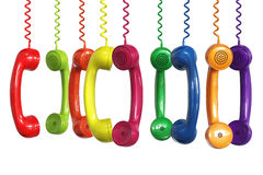 Different colors phone receivers hanging Royalty Free Stock Photo