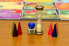 Different colors of Plastic chips with dice and Board game children. Cubes with the game monopoly on the table macro Stock Images