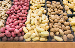 Different colors potatoes in a grocery store Royalty Free Stock Images