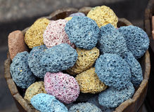 Different colors of pumice stone in shop. Royalty Free Stock Photo