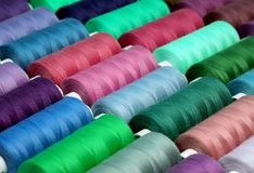 Sewing threads in spools Stock Photos