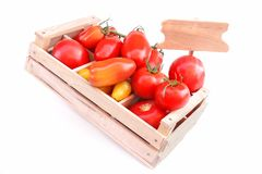 Different colors and size Tomatoes in wooden box Royalty Free Stock Photography