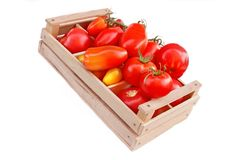 Different colors and size Tomatoes in wooden box Stock Photo